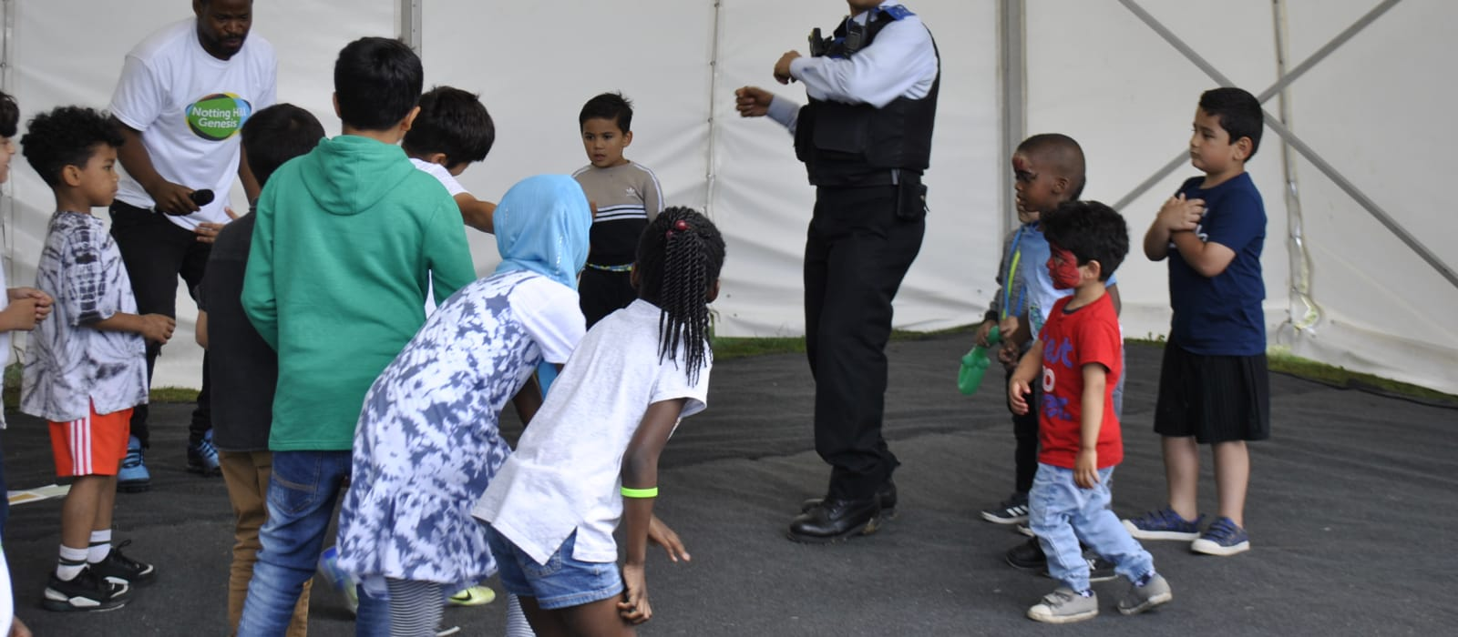 Policeman dancing with community